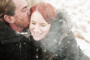 Image of couple in love kissing in the snow