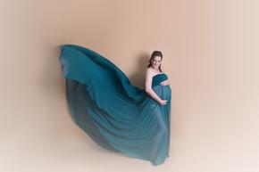 Pregnant women in green flowing dress