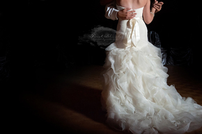 Bride and Groom dance their first dance with a single light